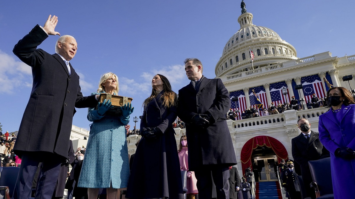 Joe Biden is sworn in as the 46th president of the United States by Chief Justice John Roberts as Jill Biden holds the Bible during the 59th Presidential Inauguration at the U.S. Capitol, in Washington, U.S., 20 January 2021. Andrew Harnik/Pool via Reuters