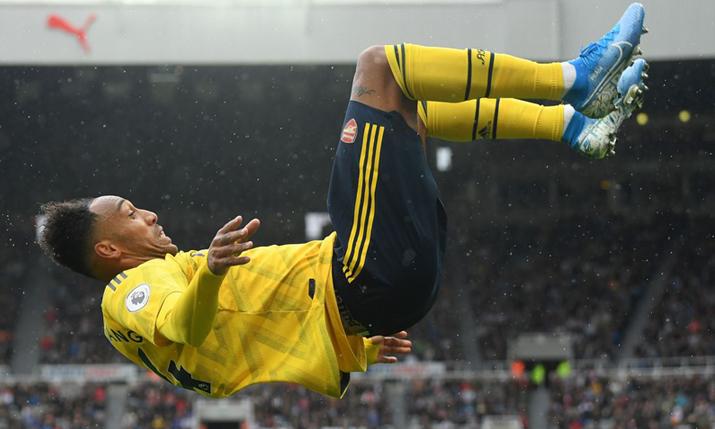 Arsenal captain Pierre-Emerick Aubameyang celebrates scoring a goal in the Premier League.