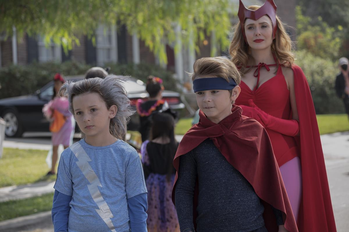 "(L-R): Jett Klyne as Tommy, Julian Hilliard as Billy and Elizabeth Olsen as Wanda Maximoff in ""WandaVision."" Cr: Marvel Studios"