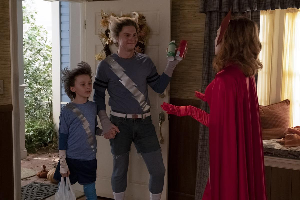 "(L-R): Jett Klyne as Tommy, Evan Peters as Pietro and Elizabeth Olsen as Wanda Maximoff in ""WandaVision."" Cr: Marvel Studios"