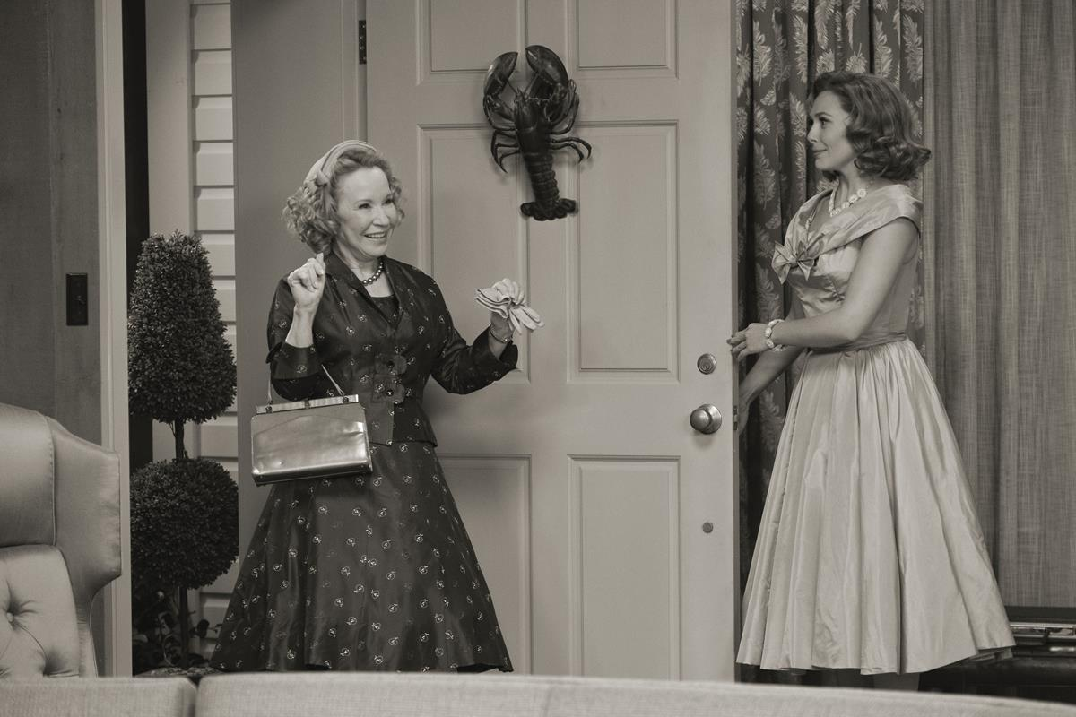 "Debra Jo Rupp as Mrs. Hart and Elizabeth Olsen as Wanda Maximoff in ""WandaVision."" Cr: Marvel Studios"