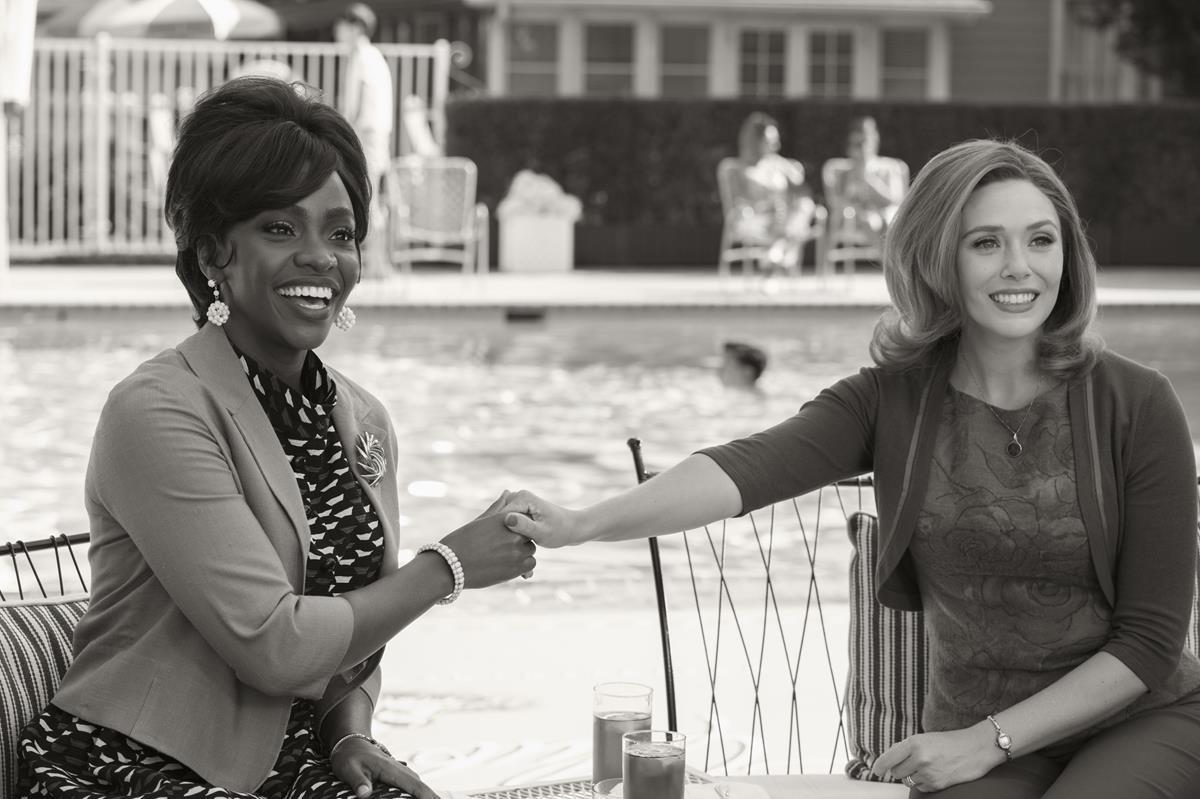 "(L-R): Teyonah Parris as Monica Rambeau and Elizabeth Olsen as Wanda Maximoff in ""WandaVision."" Cr: Marvel Studios"