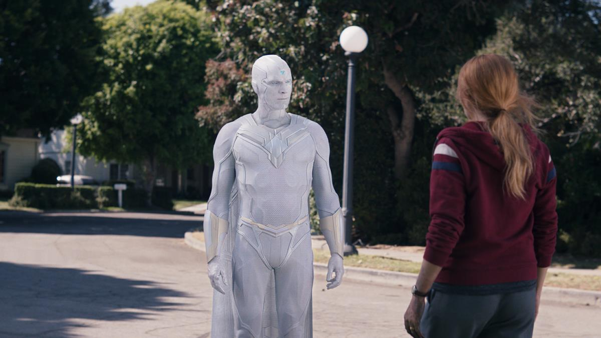 "Paul Bettany as The Vision and Elizabeth Olsen as Wanda Maximoff in ""WandaVision."" Cr: Marvel Studios"
