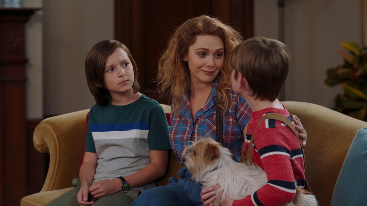 "(L-R): Jett Klyne as Tommy, Elizabeth Olsen as Wanda Maximoff and Julian Hilliard as Billy in ""WandaVision."" Cr: Marvel Studios"