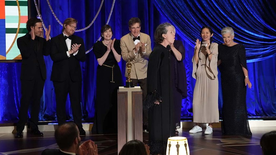 """Frances McDormand on stage with the producers of """"Nomadland,"""" which took home the Oscars for Best Picture, Best Director and Best Actress. Cr: AMPAS/ABC"""