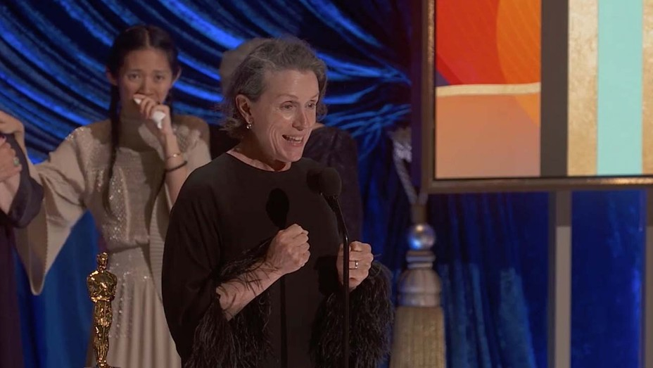 """2021 Academy Award Best Actress Frances McDormand for """"Nomadland,"""" with Best Director Chloe Zhao in the background. Cr: AMPAS/ABC"""