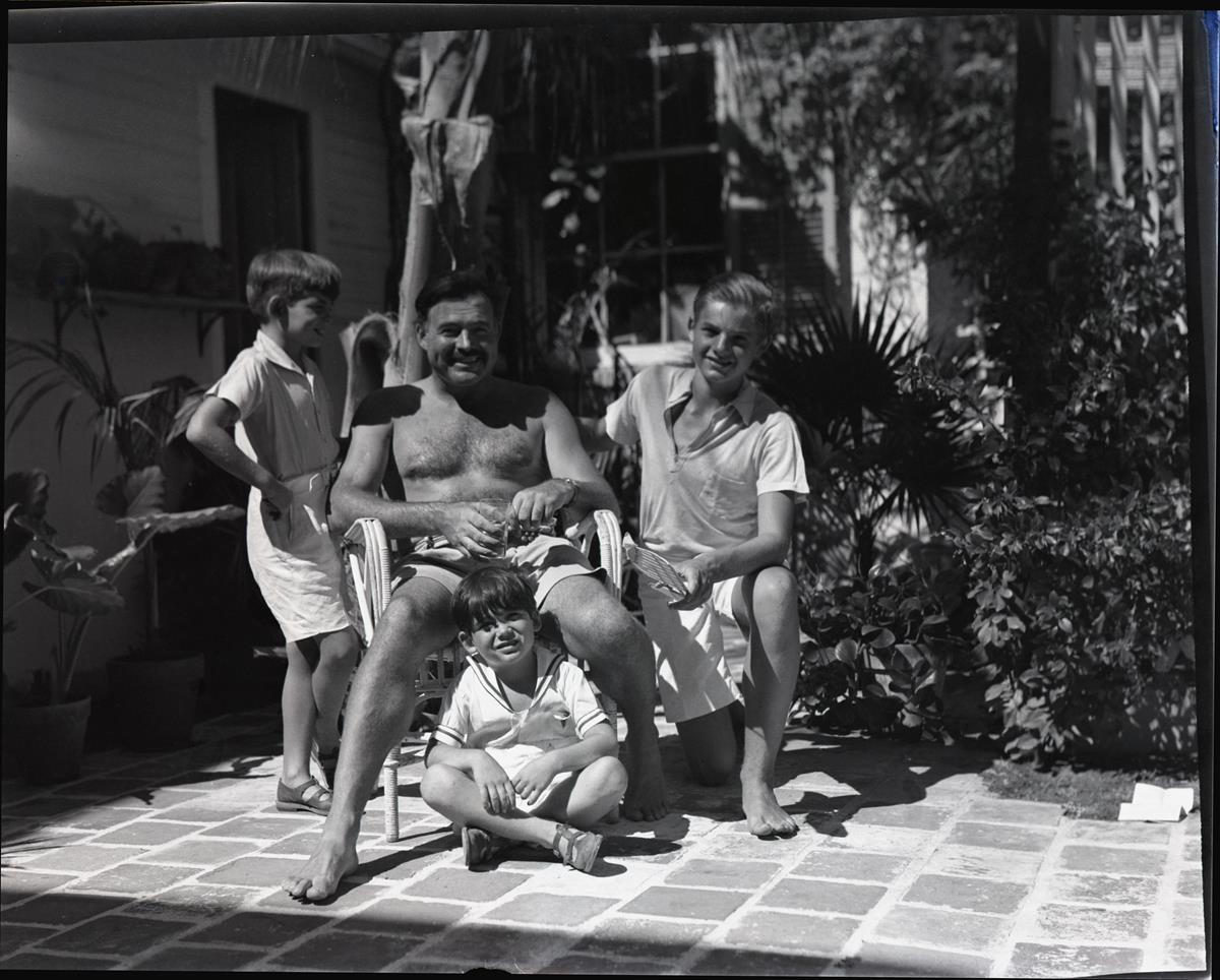 Ernest Hemingway with his three sons, Jack, Patrick, and Gregory at his Key West home. Cr: Patrick Hemingway Papers, Manuscripts Division, Department of Special Collections, Princeton University Library