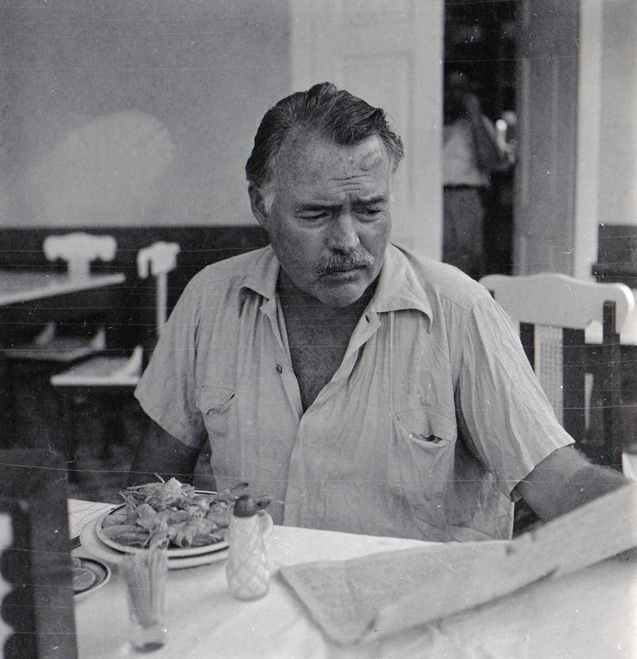 Ernest Hemingway reading a newspaper, Cuba, 1947-1948. Cr: Ernest Hemingway Collection. John F. Kennedy Presidential Library and Museum, Boston