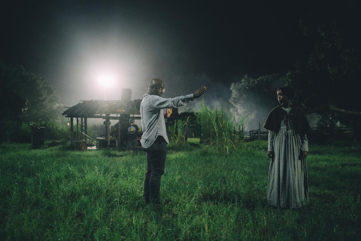 """Barry Jenkins and Thuso Mbedu on the set of """"The Underground Railroad."""" Cr: Atsushi Nishijima/Amazon Studios"""