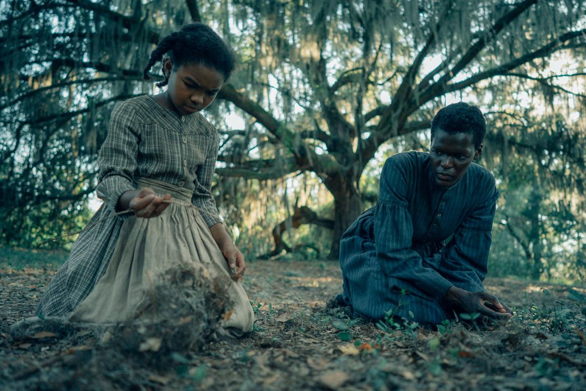 """Mikaela Kimani Armstrong as young Cora and Sheila Atim as her mother Mabel in """"The Underground Railroad."""" Cr: Amazon Studios"""