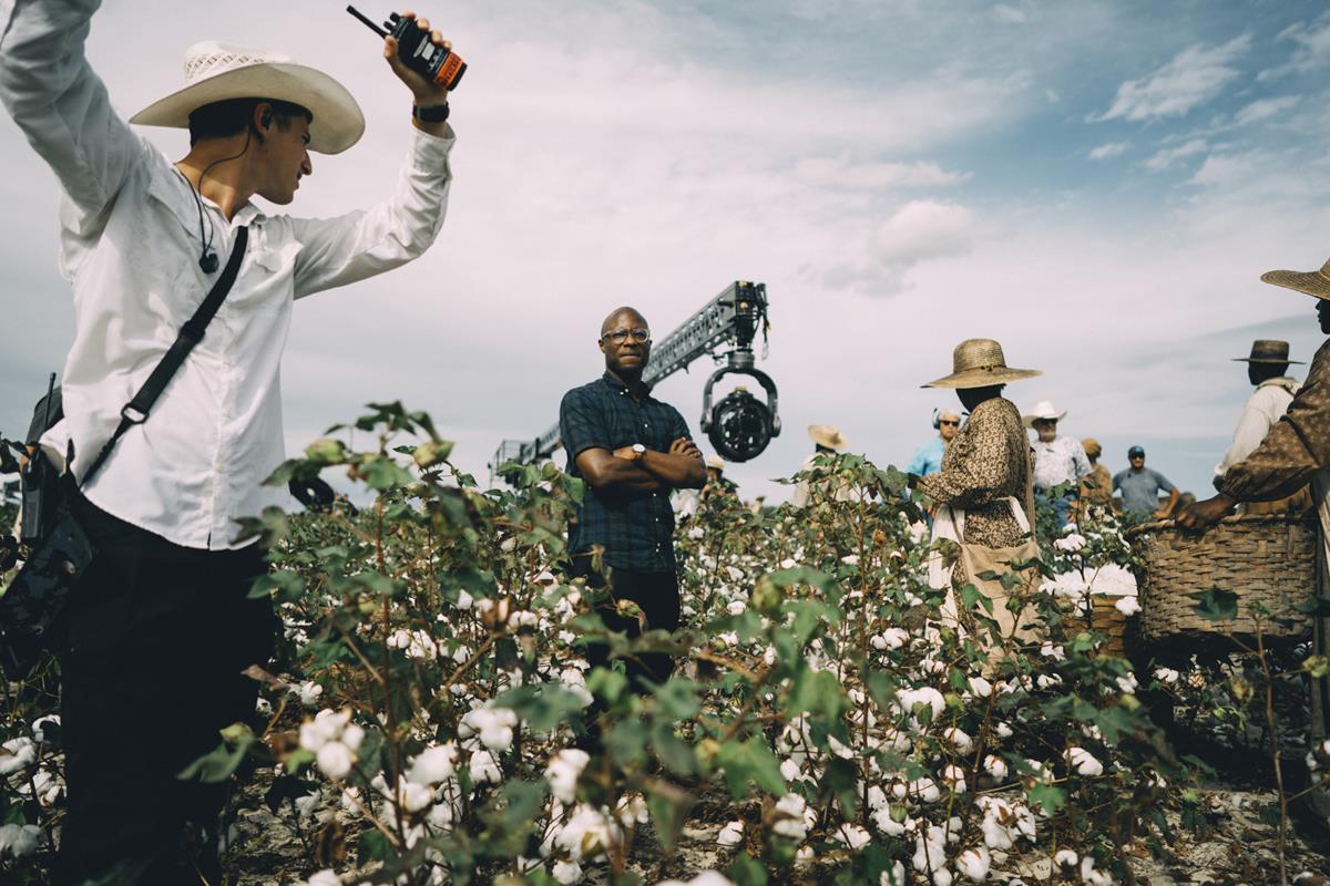 "Showrunner Barry Jenkins (center) on location while filming ""The Underground Railroad."" Cr: Atsushi Nishijima/Amazon Studios"