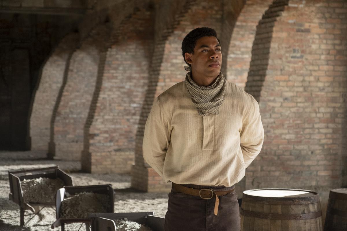 "Aaron Pierre as Caesar in ""The Underground Railroad."" Cr: Kyle Kaplan/Amazon Studios"