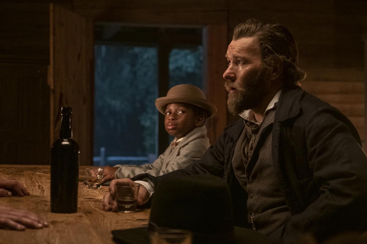 "Chase Dillon as Homer and Joel Edgerton as slave catcher Arnold Ridgeway in ""The Underground Railroad."" Cr: Kyle Kaplan/Amazon Studios"