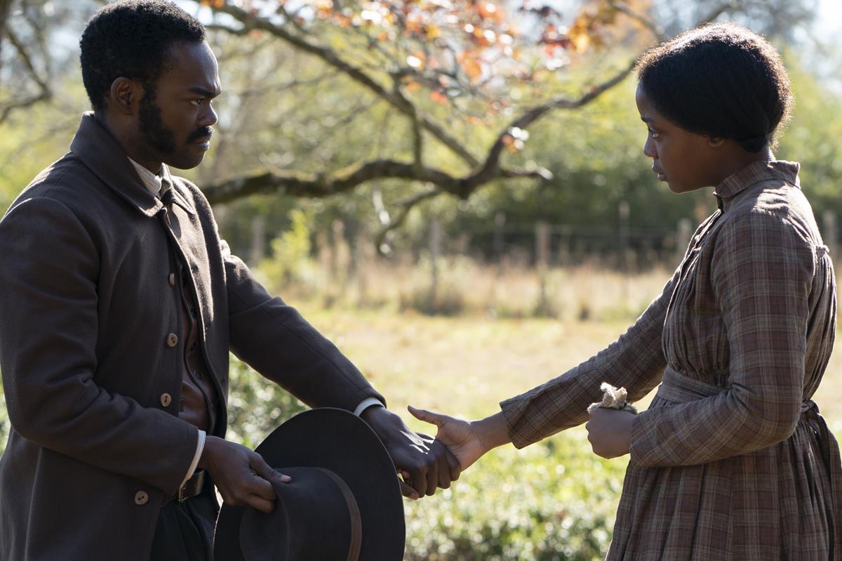 "William Jackson Harper as Royal and Thuso Mbedu as Cora in ""The Underground Railroad."" Cr: Atsushi Nishijima/Amazon Studios"
