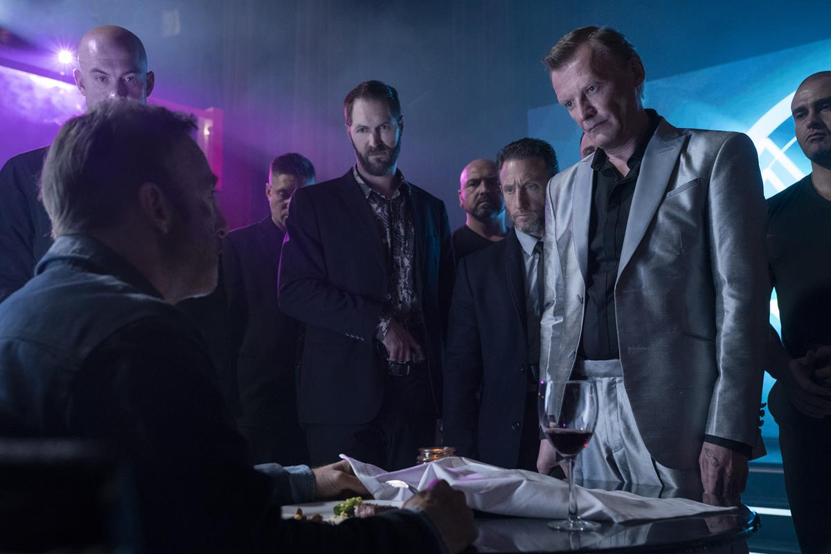 "Bob Odenkirk as Hutch Mansell, Neil Davison as Albert, Alexey Serebryakov as Yulian Kuznetsov, with members of the Russian mafia in ""Nobody,"" directed by Ilya Naishuller. Cr: Allen Fraser/Universal Pictures"