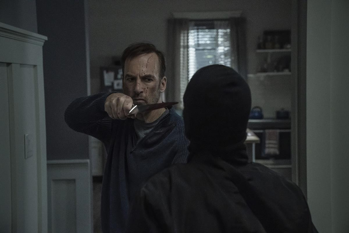 """Bob Odenkirk as Hutch Mansell and a member of the Russian mafia in """"Nobody,"""" directed by Ilya Naishuller. Cr: Allen Fraser/Universal Pictures"""