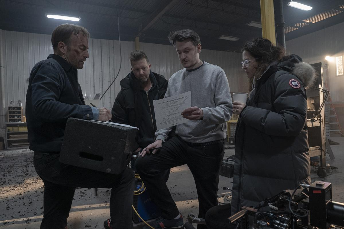 """Bob Odenkirk, producer David Leitch, director Ilya Naishuller and producer Kelly McCormick on the set of """"Nobody."""" Cr: Allen Fraser/Universal Pictures"""