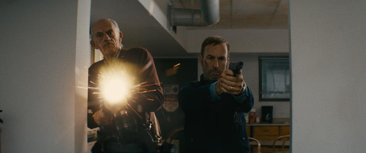 """Christopher Lloyd as David Mansell and Bob Odenkirk as Hutch Mansell in """"Nobody,"""" directed by Ilya Naishuller. Cr: Allen Fraser/Universal Pictures"""