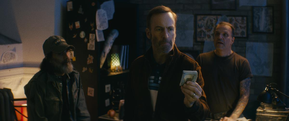 """Stephen McIntyre as a U.S. Veteran, Bob Odenkirk as Hutch Mansell and Rick Dobran as a tattoo shop owner in """"Nobody,"""" directed by Ilya Naishuller. Cr: Allen Fraser/Universal Pictures"""