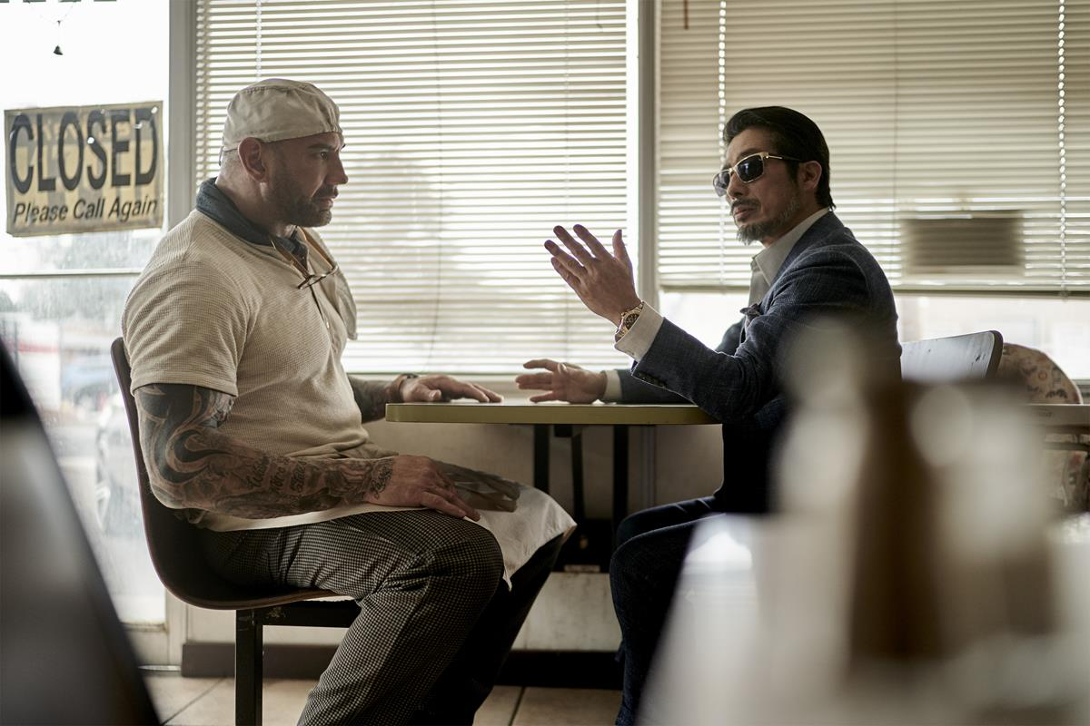 """Dave Bautista as Scott Ward and Hiroyuki Sanada as Tanaka in """"Army of the Dead,"""" written and directed by Zack Snyder. Cr: Clay Enos/Netflix"""