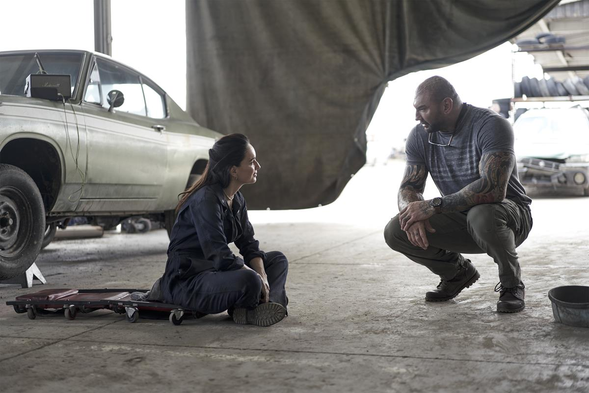 """Ana de la Reguera as Cruz and Dave Bautista as Scott Ward in """"Army of the Dead,"""" written and directed by Zack Snyder. Cr: Clay Enos/Netflix"""
