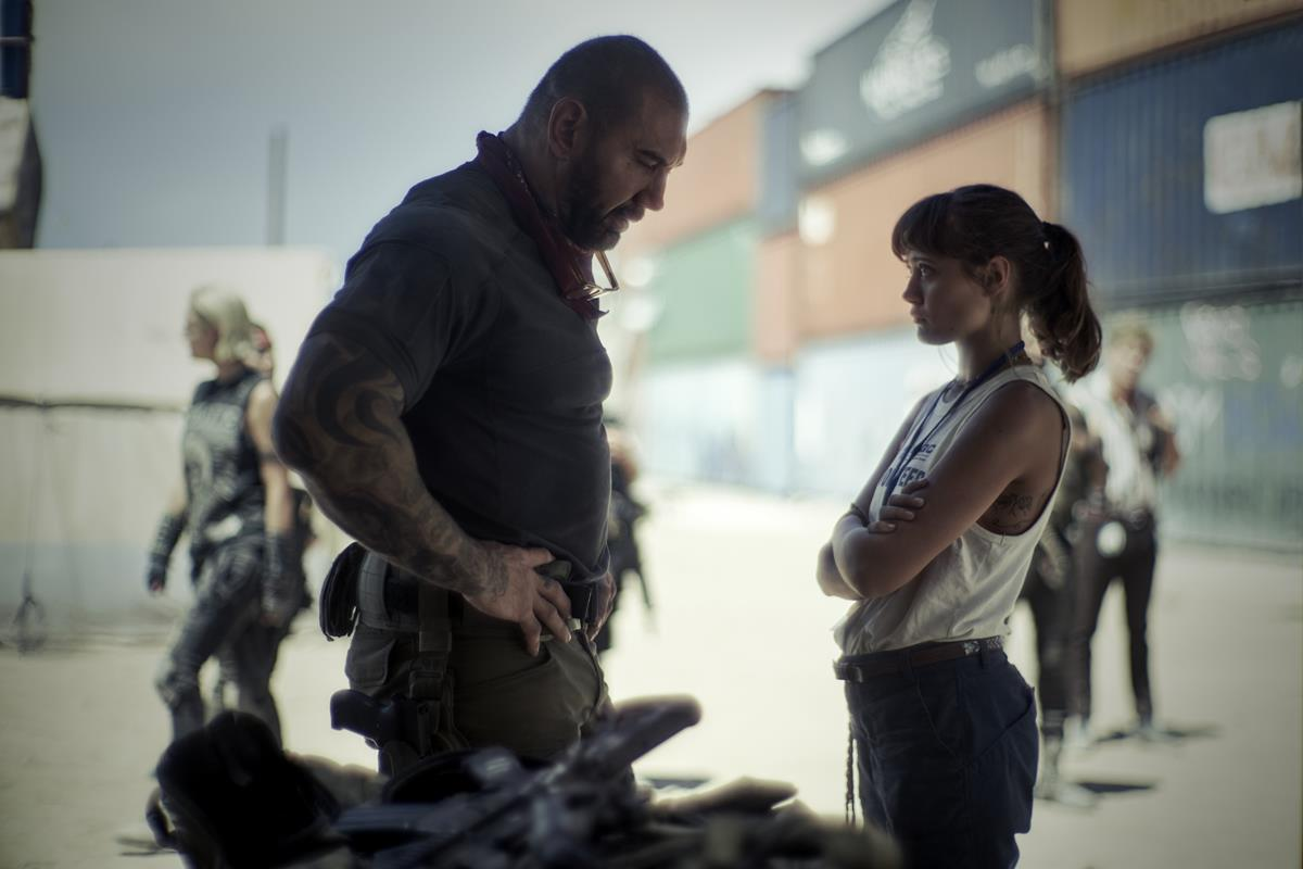 """Dave Bautista as Scott Ward and Ella Purnell as Kate Ward in """"Army of the Dead,"""" written and directed by Zack Snyder. Cr: Clay Enos/Netflix"""