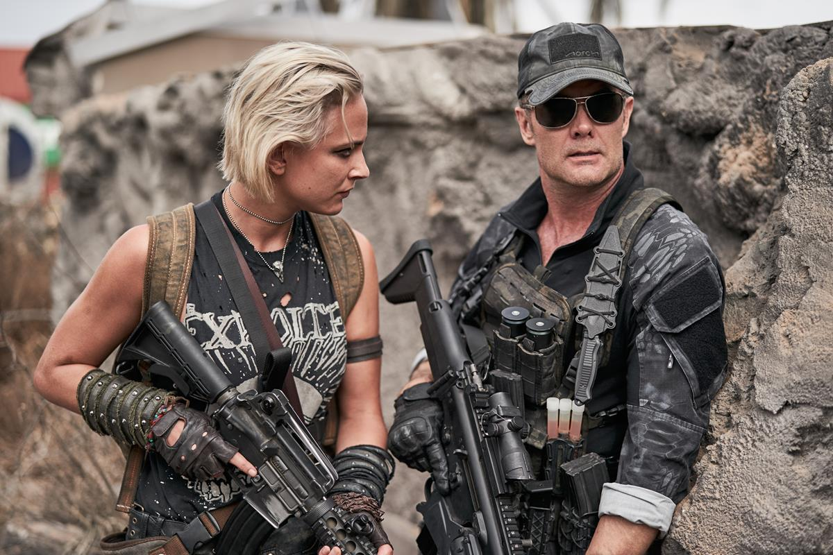 """Nora Arnezeder as Lilly """"The Coyote"""" and Garret Dillahunt as Martin in """"Army of the Dead,"""" written and directed by Zack Snyder. Cr: Clay Enos/Netflix"""