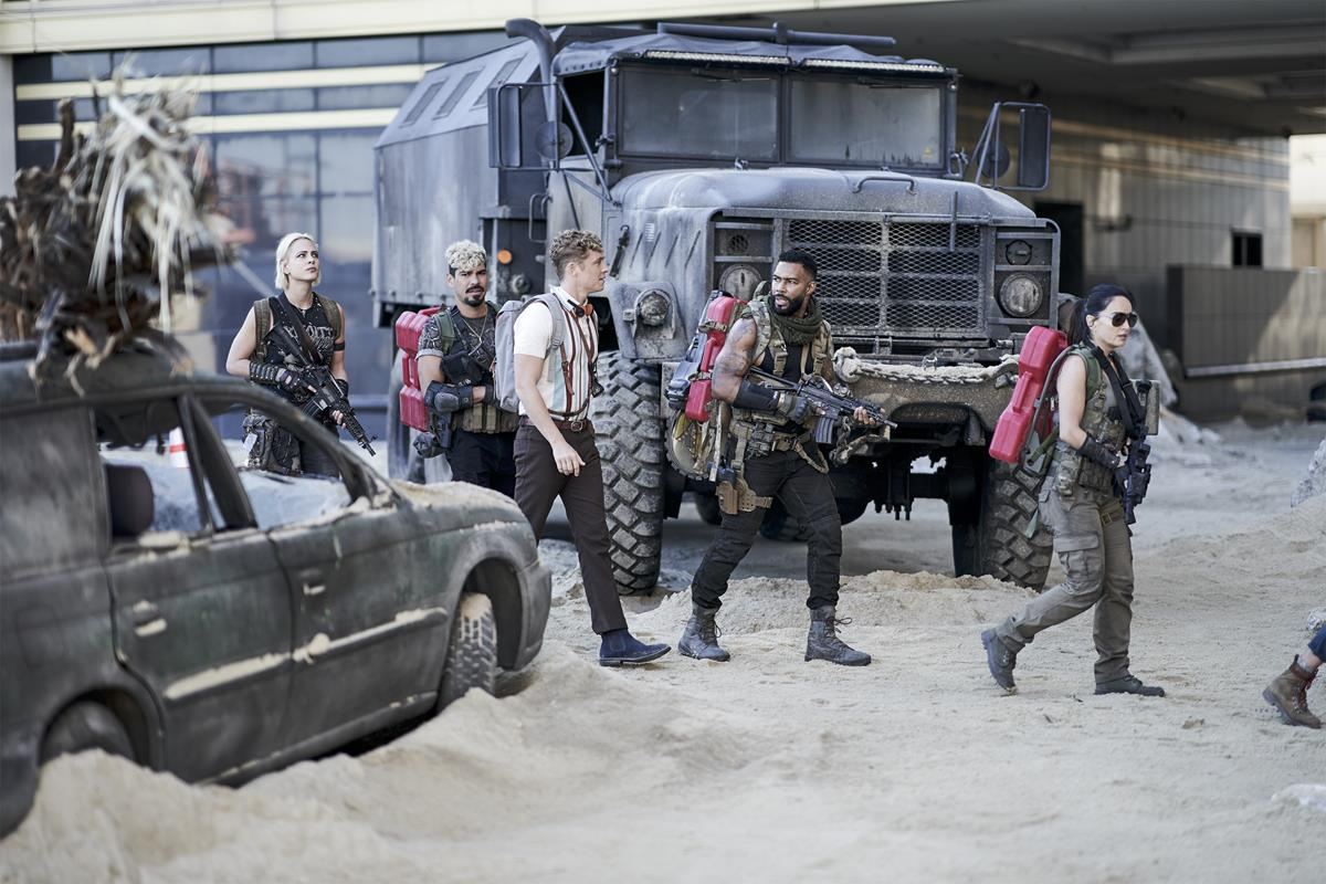 """Ana De La Reguera as Cruz, Matthias Schweighöfer as Dieter, Omari Hardwick as Vanderohe, Raúl Castillo as Mickey Guzman and Nora Arnezeder as Lilly """"The Coyote"""" in """"Army of the Dead,"""" written and directed by Zack Snyder. Cr: Clay Enos/Netflix"""