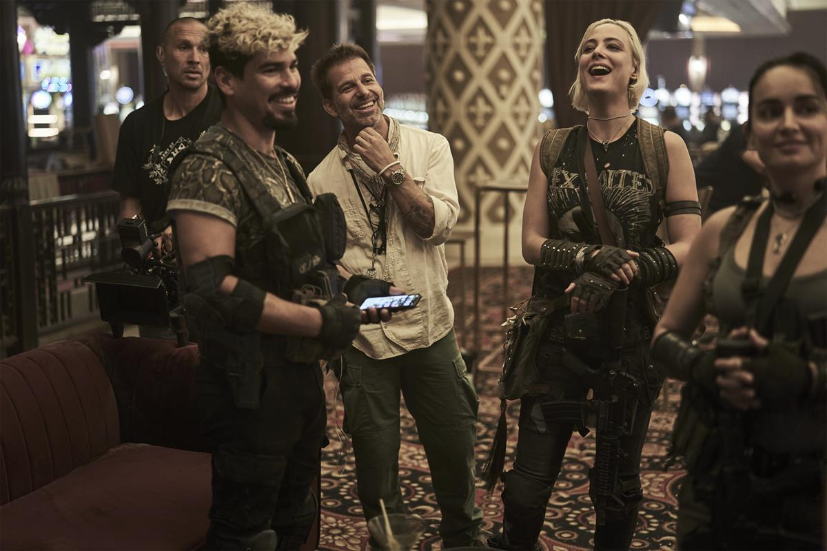 """Raùl Castillo and director, producer and writer Zack Snyder with Nora Arnezeder and Ana De la Reguera on the set of """"Army of the Dead."""" Cr: Clay Enos/Netflix"""