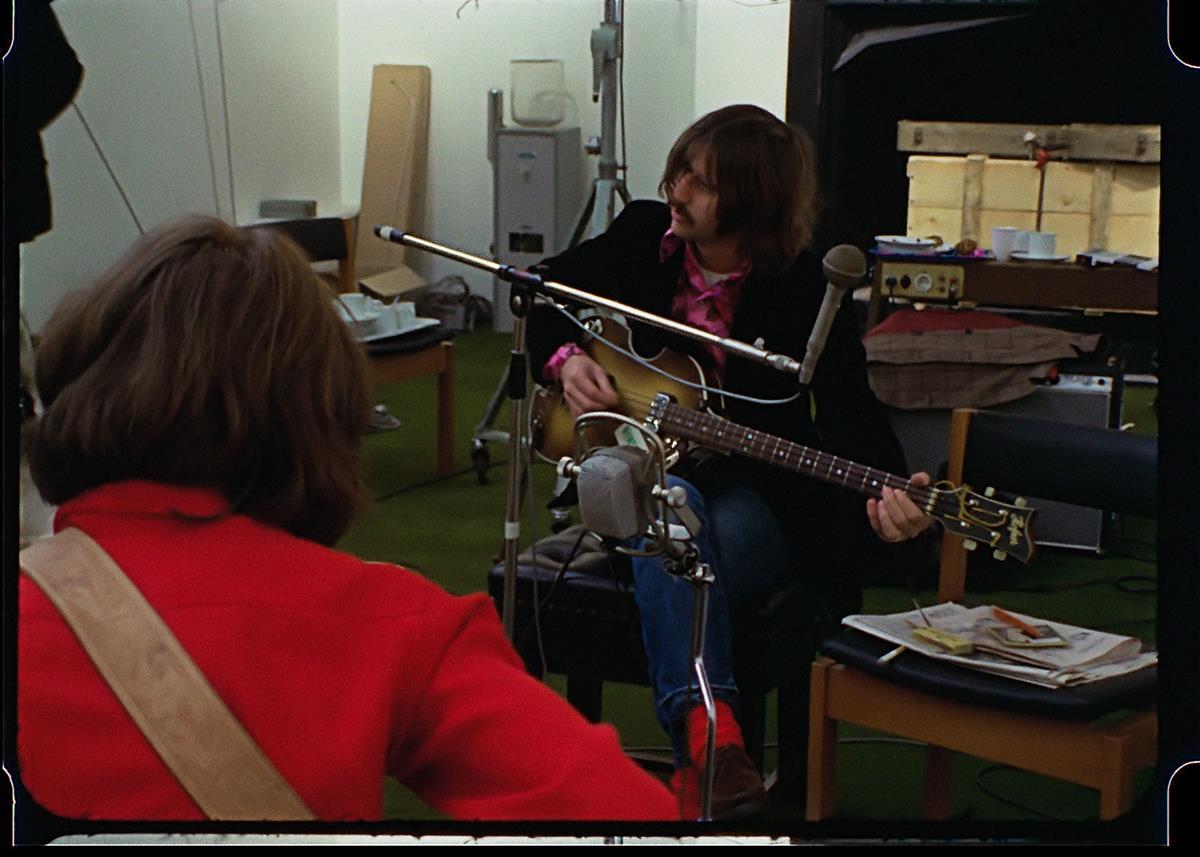 "Ringo Starr fiddling around on McCartney's bass. ""The Beatles: Get Back."" Cr: Apple Corps Ltd./Disney"