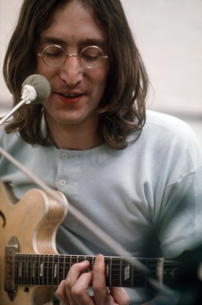 "John Lennon during a rehearsal. ""The Beatles: Get Back."" Cr: Apple Corps Ltd./Disney"