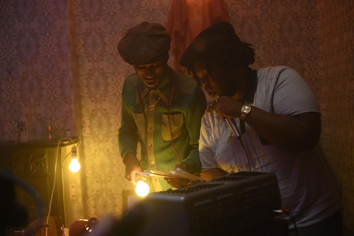 "Alexander James-Blake as Parker B and Kadeem Ramsay as Samson in ""Lovers Rock."" Cr: Parisa Taghizedeh/Amazon Prime Video"
