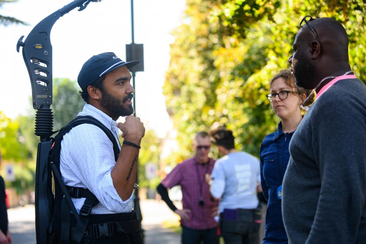 """Cinematographer Shabier Kirchner with script supervisor Phoebe Billington and co-writer and director Steve McQueen on the set of """"Lovers Rock."""" Cr: Parisa Taghizedeh/Amazon Prime Video"""