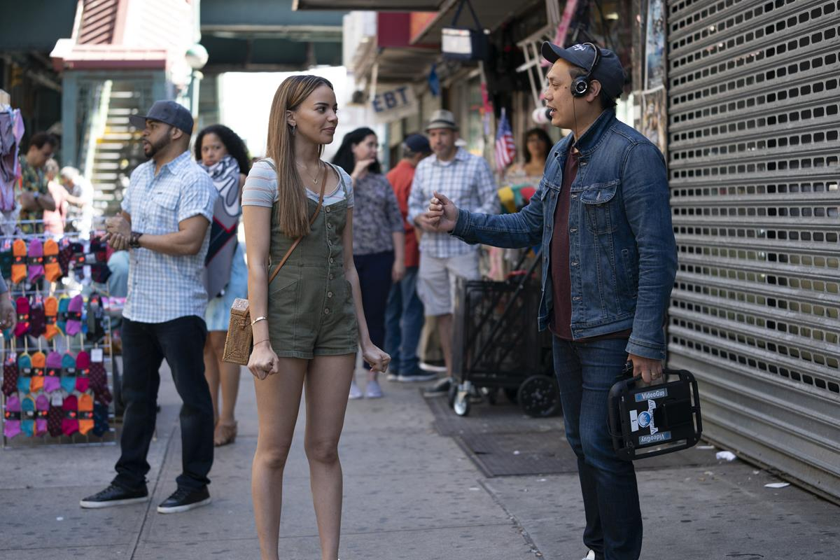 """Leslie Grace and director Jon M. Chu on the set of the screen adaptation of """"In The Heights."""" Cr: Macall Polay/Warner Bros."""