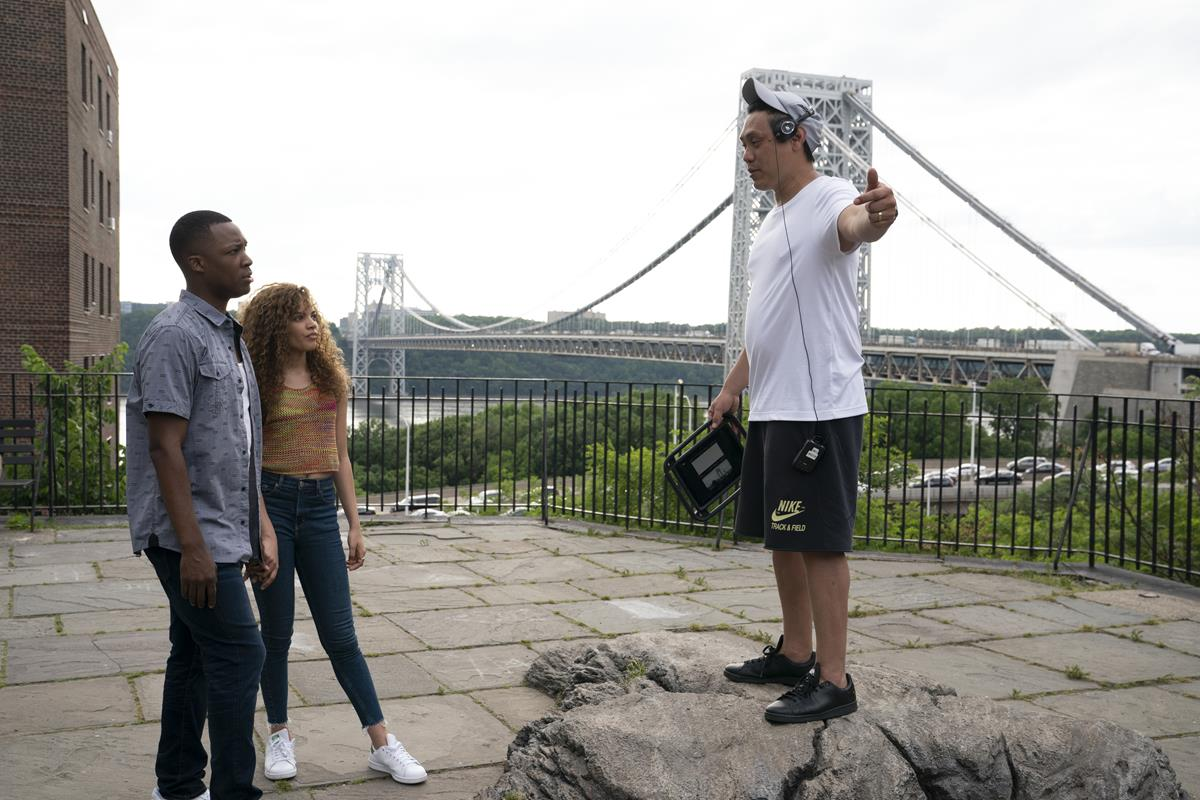 """Corey Hawkins, Leslie Grace and director Jon M. Chu on the set of the screen adaptation of """"In The Heights."""" Cr: Macall Polay/Warner Bros."""
