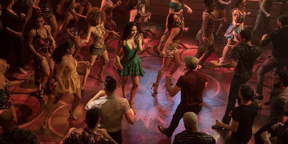 """Melissa Barrera (center) as Vanessa in director Jon M. Chu's screen adaptation of """"In The Heights."""" Cr: Macall Polay/Warner Bros."""