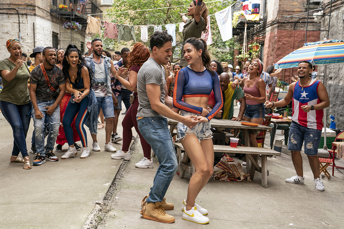 """Left to right: Anthony Ramos as Usnavi and Melissa Barrera as Vanessa in Warner Bros. Pictures' """"In the Heights,"""" a Warner Bros. Pictures release."""