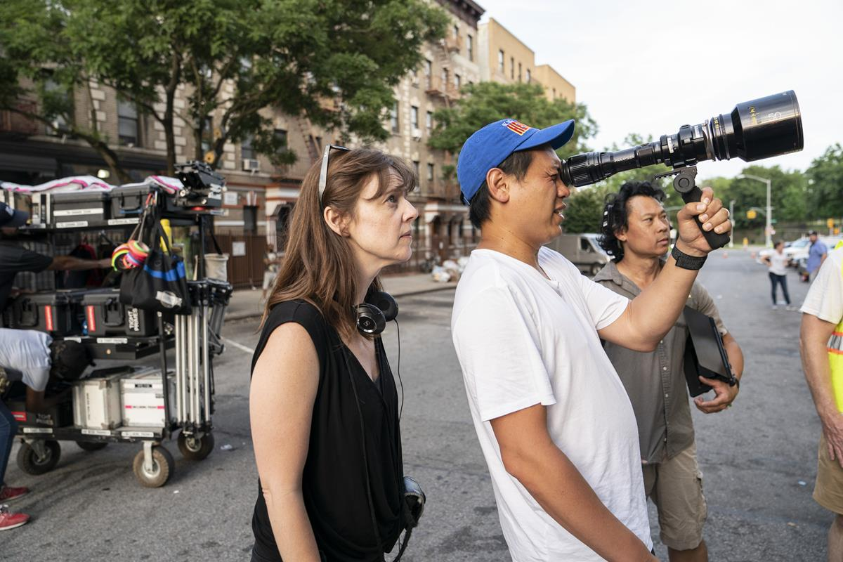 """Director of photography Alice Brooks and director Jon M. Chu on the set of the screen adaptation of """"In The Heights."""" Cr: Macall Polay/Warner Bros."""