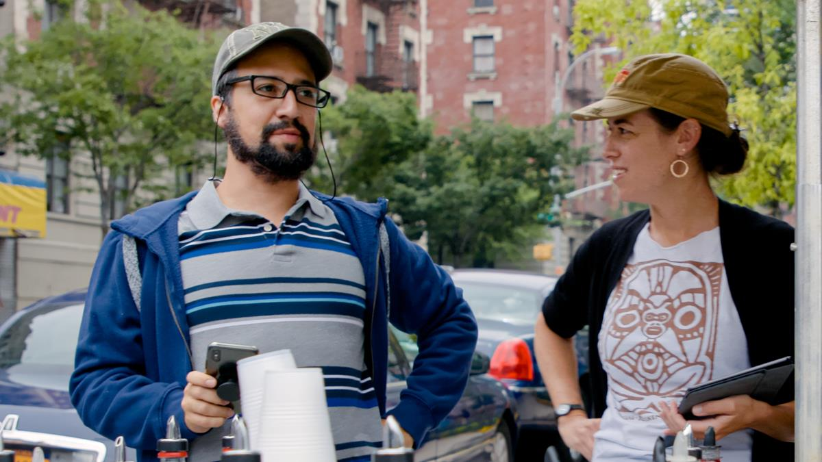 "Concept/music & lyrics/producer Lin-Manuel Miranda and Quiara Alegría Hudes on the set of director Jon M. Chu's screen adaptation of ""In The Heights."" Cr: Macall Polay/Warner Bros."