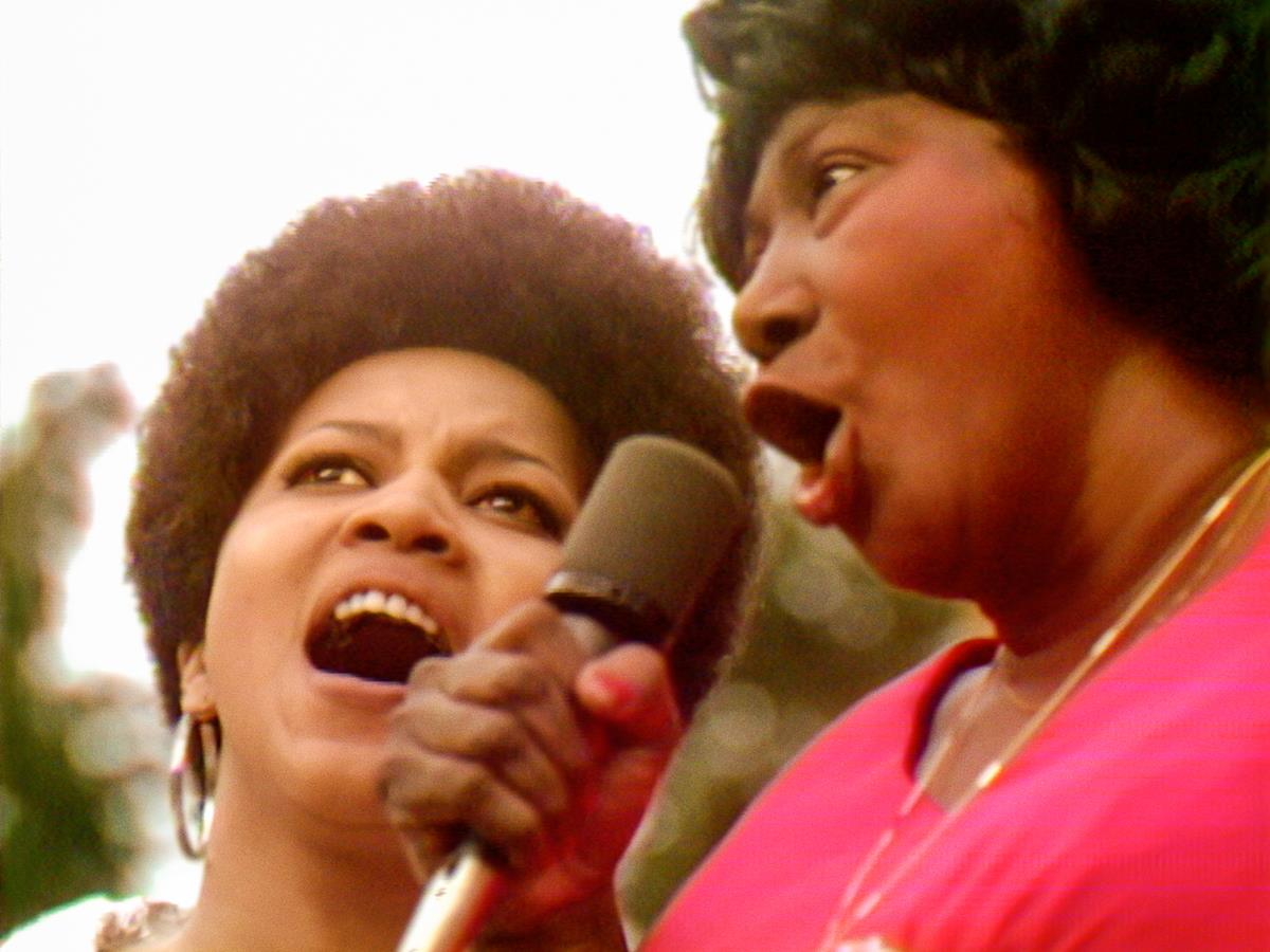 """Mavis Staples and Mahalia Jackson performing at the Harlem Cultural Festival in 1969, featured in the documentary """"Summer Of Soul (Or, When The Revolution Could Not Be Televised)."""" Cr: Mass Distraction Media/Searchlight Pictures"""