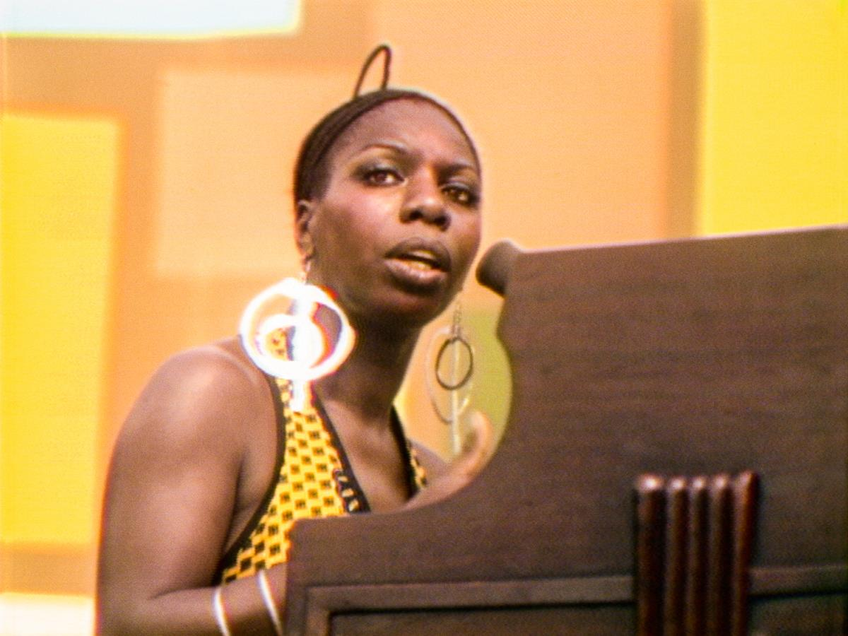 """Nina Simone performs at the Harlem Cultural Festival in 1969, featured in the documentary """"Summer Of Soul (Or, When The Revolution Could Not Be Televised)."""" Cr: Mass Distraction Media/Searchlight Pictures"""