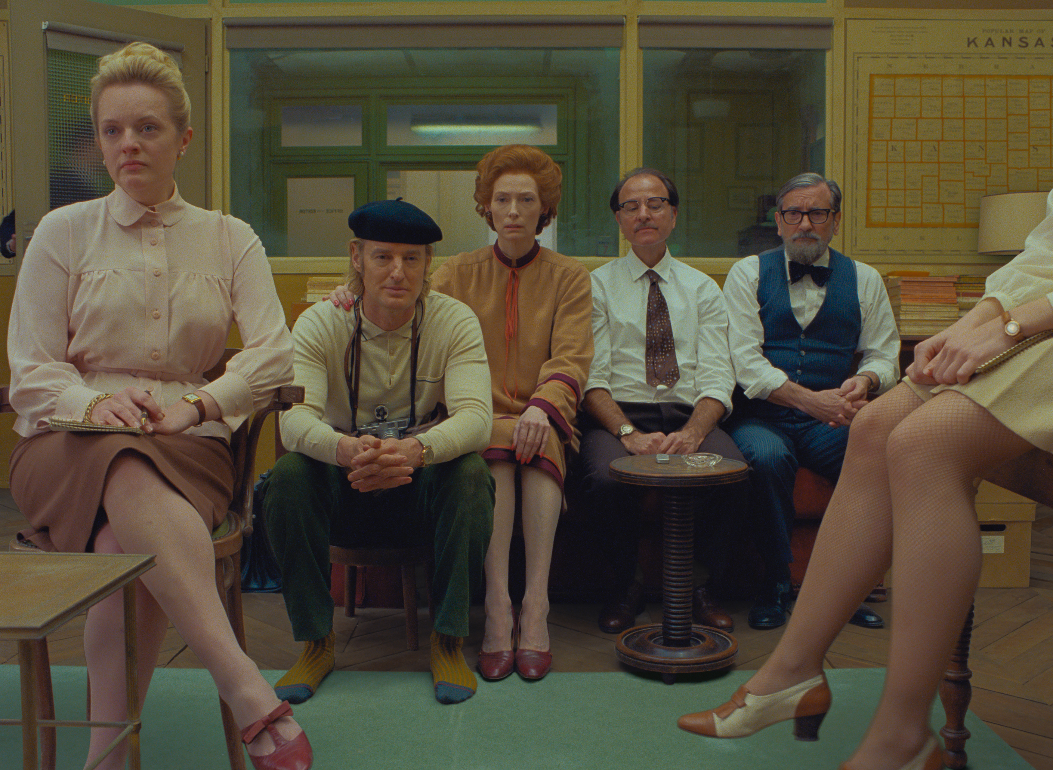 (From L-R): Elisabeth Moss, Owen Wilson, Tilda Swinton, Fisher Stevens and Griffin Dunne in the film THE FRENCH DISPATCH. Photo Courtesy of  Searchlight Pictures. © 2020 Twentieth Century Fox Film Corporation All Rights Reserved