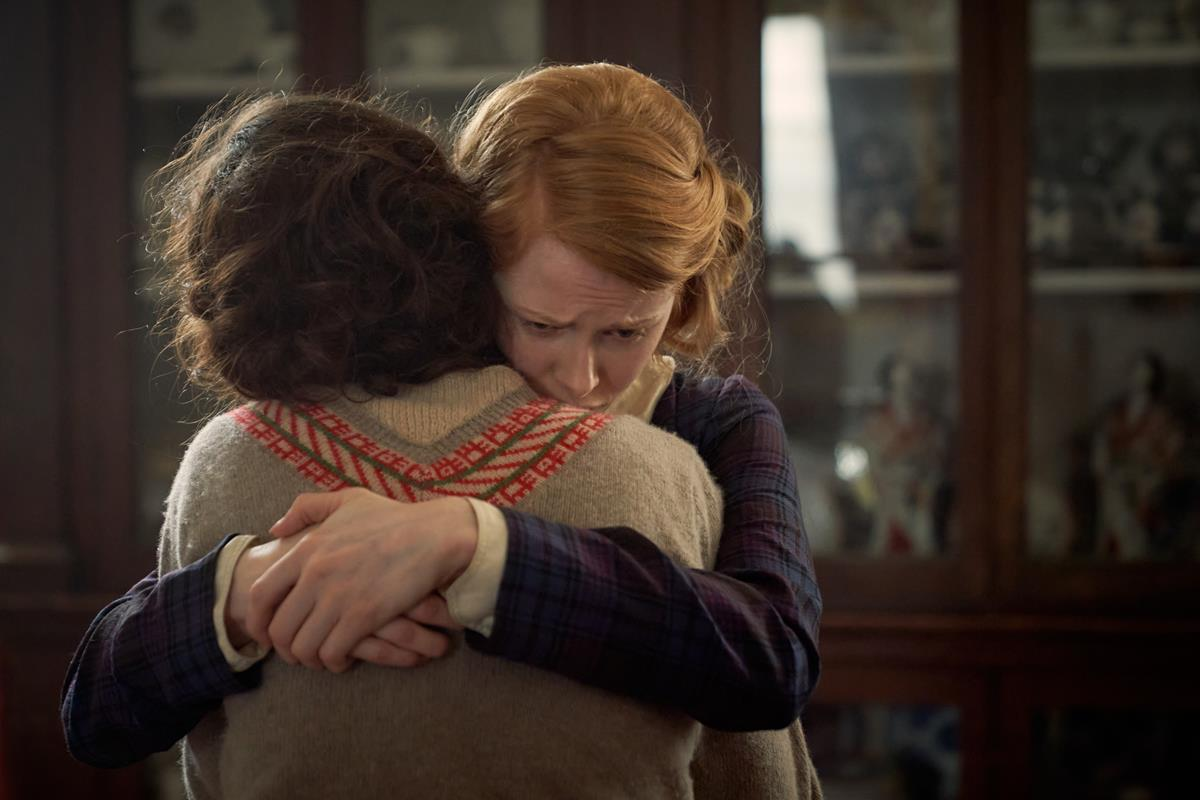 """Lily James as Linda Radlett and Emily Beecham as Fanny Logan in """"The Pursuit of Love."""" Cr: Robert Viglasky/BBC"""
