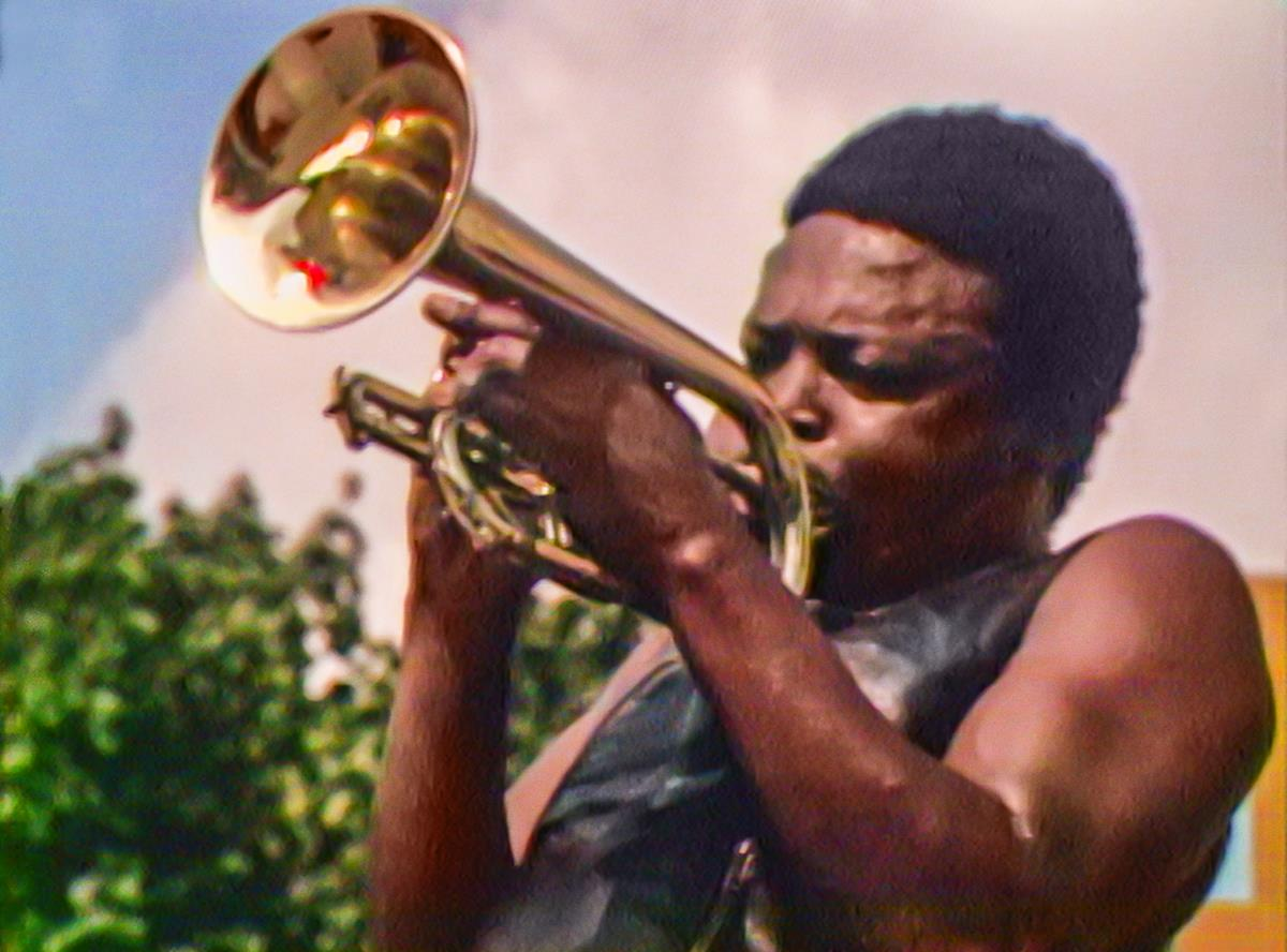 """Hugh Masekela performs at the Harlem Cultural Festival in 1969, featured in the documentary """"Summer Of Soul (Or, When The Revolution Could Not Be Televised)."""" Cr: Mass Distraction Media/Searchlight Pictures"""