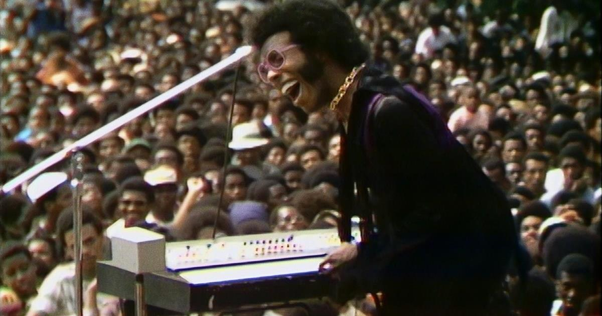 """Sly Stone performs at the Harlem Cultural Festival in 1969, featured in the documentary """"Summer Of Soul (Or, When The Revolution Could Not Be Televised)."""" Cr: Mass Distraction Media/Searchlight Pictures"""