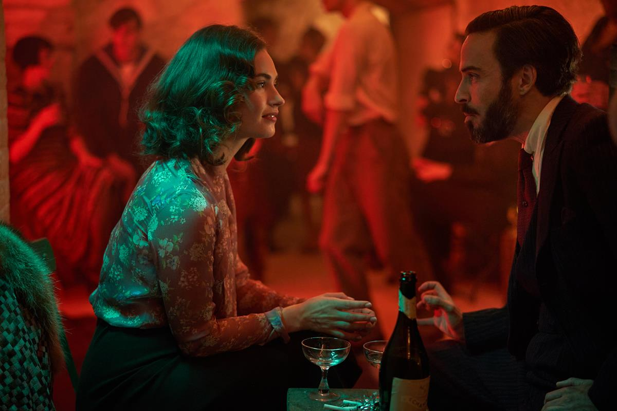 """Lily James as Linda Radlett and Assaad Bouab as Fabrice De Sauveterre in """"The Pursuit of Love."""" Cr: Robert Viglasky/BBC"""