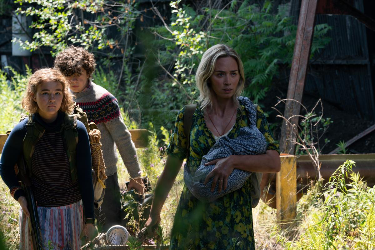 """Regan (Millicent Simmonds), Marcus (Noah Jupe) and Evelyn (Emily Blunt) brave the unknown in """"A Quiet Place Part II."""" Cr: Paramount Pictures"""