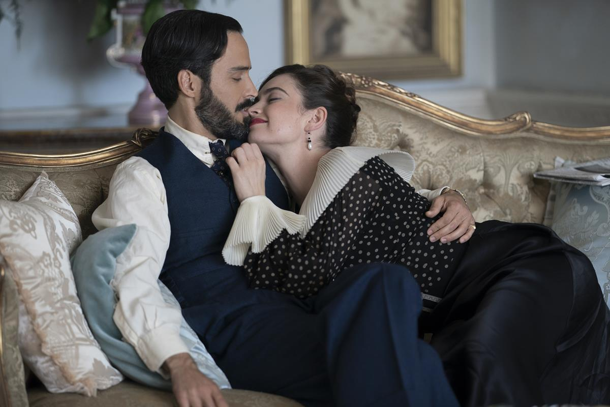"""Assaad Bouab as Fabrice De Sauveterre and Lily James as Linda Radlett in """"The Pursuit of Love."""" Cr: Robert Viglasky/BBC"""