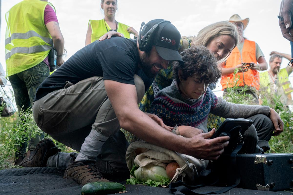 """Director John Krasinski, Noah Jupe and Emily Blunt on the set of """"A Quiet Place Part II."""" Cr: Paramount Pictures"""