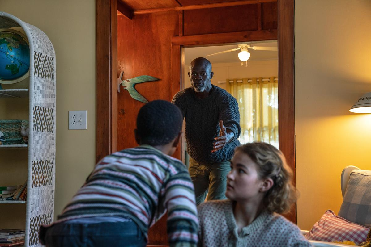 """Man on Island (Djimon Hounsou) and Regan (Millicent Simmonds) brave the unknown in """"A Quiet Place Part II."""" Cr: Paramount Pictures"""